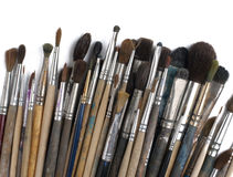 Assorted dirty old painting brushes. Isolated on Stock Image