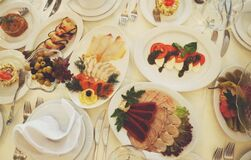 Assorted Dishes Served on White Ceramic Oval Plate on the Table Stock Photography