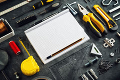 Assorted Do It Yourself Tools and Notebook Stock Photography