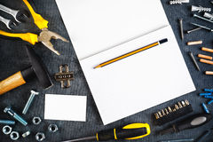 Assorted Do It Yourself Tools and Notebook Royalty Free Stock Image