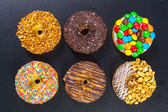 Assorted donuts from above stock images