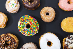 Assorted donuts on black background Stock Photo