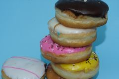 Assorted donuts on a blue background. Many Assorted donuts on a background royalty free stock images