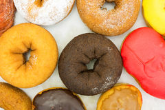 Assorted donuts in box top close view Stock Photo