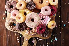 Assorted donuts with chocolate frosted, pink glazed and sprinkle. S donuts Royalty Free Stock Photos