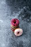 Assorted donuts with chocolate frosted, pink glazed and sprinkle. S donuts Stock Photography