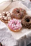 Assorted donuts with chocolate frosted, pink glazed and sprinkle. S donuts Stock Photo
