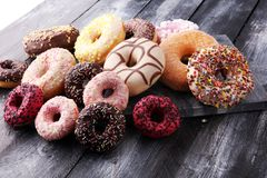 Assorted donuts with chocolate frosted, pink glazed and sprinkle. S donuts Royalty Free Stock Photography