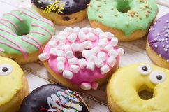 Beauty assorted donuts. Assorted donuts with chocolate frosted, pink glazed and sprinkles royalty free stock photo