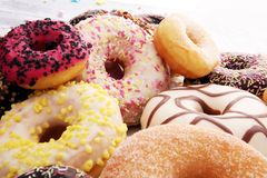 Assorted donuts with chocolate frosted, pink glazed and sprinkle. S donuts Stock Photos