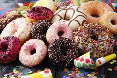 Assorted donuts with chocolate frosted, pink glazed and sprinkle. S donuts Royalty Free Stock Image