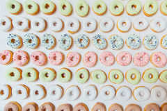 Assorted donuts with chocolate frosted, pink glazed and sprinkles donuts. Royalty Free Stock Image