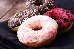 Assorted donuts with chocolate frosted, pink glazed and sprinkle. S donuts Royalty Free Stock Photo