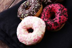 Assorted donuts with chocolate frosted, pink glazed and sprinkle. S donuts Royalty Free Stock Images
