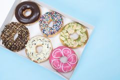 Donuts are sweet and harmful to health. stock photos