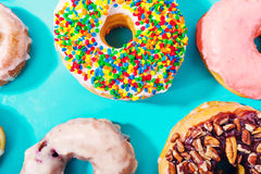 Assorted donuts on pastel blue background Royalty Free Stock Image