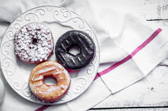 Assorted donuts on rustic wooden background Stock Image