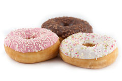 Assorted donuts on white background Royalty Free Stock Images