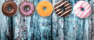 Assorted donuts on wooden background1 royalty free stock photography