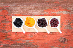 Assorted dried berries and fruit in ramekins Stock Photo