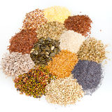 Assorted dried culinary seeds in piles Royalty Free Stock Image