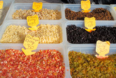 Assorted dried fruits in plastic boxes. On a market stock images