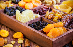 Assorted dried fruits in wooden box Stock Photos