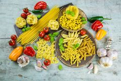 Assorted Italian pasta with fresh ingredients Royalty Free Stock Image