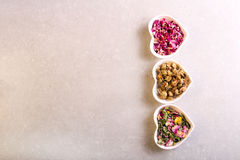 Assorted dried petals and herbs used for tea Royalty Free Stock Photos