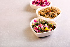 Assorted dried petals and herbs used for tea, perfumes Stock Photography