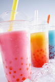 Assorted Drinks. Assorted Bubble Tea Drinks on crushed ice with fruit pearls Stock Photos