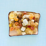 Assorted dry fruits. Cut to squares for seasoning in a square ceramic bowl on retro background Royalty Free Stock Image