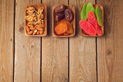 Assorted dry fruits and nuts on wooden table. View from above Stock Photography