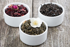 Assorted dry herbal teas in white bowls Royalty Free Stock Image