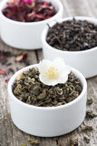Assorted dry herbal teas in white bowls, close-up Stock Photos