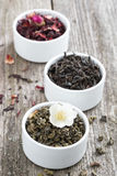 Assorted dry herbal teas in white bowls, vertical Stock Photography