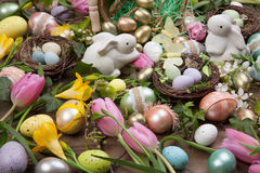 Assorted eggs and flowers for Easter Stock Images