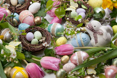 Assorted eggs and flowers for Easter on white Royalty Free Stock Photo