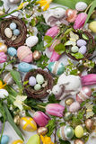 Assorted eggs and flowers for Easter on white Stock Photo
