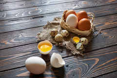 Assorted eggs rural composition. With solar lighting on wood background Royalty Free Stock Photos