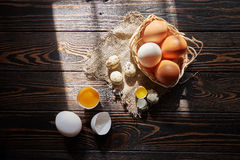 Assorted eggs rural composition. With window sunlight on wood background Stock Image