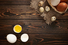 Assorted eggs rural composition. On wood background Stock Photos