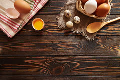 Assorted eggs rural composition. On wood background Stock Photography