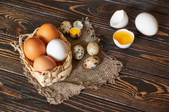 Assorted eggs rural composition. On wood background Royalty Free Stock Photography