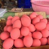 Assorted Eggs in Stalls available for sales at festival, cooking, restaurant. Varieties of hard skin Eggs in pink preserved boiled egg, salt preserved duck royalty free stock images