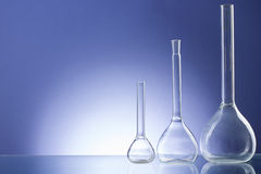 Assorted empty laboratory glassware, test-tubes. Blue tone medical background. Copy space Stock Image