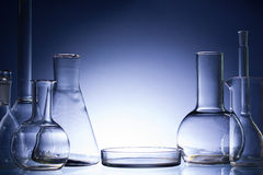 Assorted empty laboratory glassware, test-tubes. Blue tone medical background. Copy space Stock Images