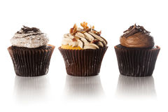Assorted Fancy Gourmet Cupcakes with Frosting. On a Background Stock Images