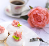 Assorted fancy gourmet cupcakes on a plate. Cupcakes with beautiful decoration over white vintage lace background. Stock Photography