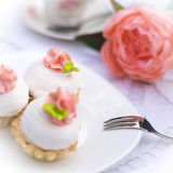 Assorted fancy gourmet cupcakes on a plate. Cupcakes with beautiful decoration over white vintage lace background. Royalty Free Stock Photos